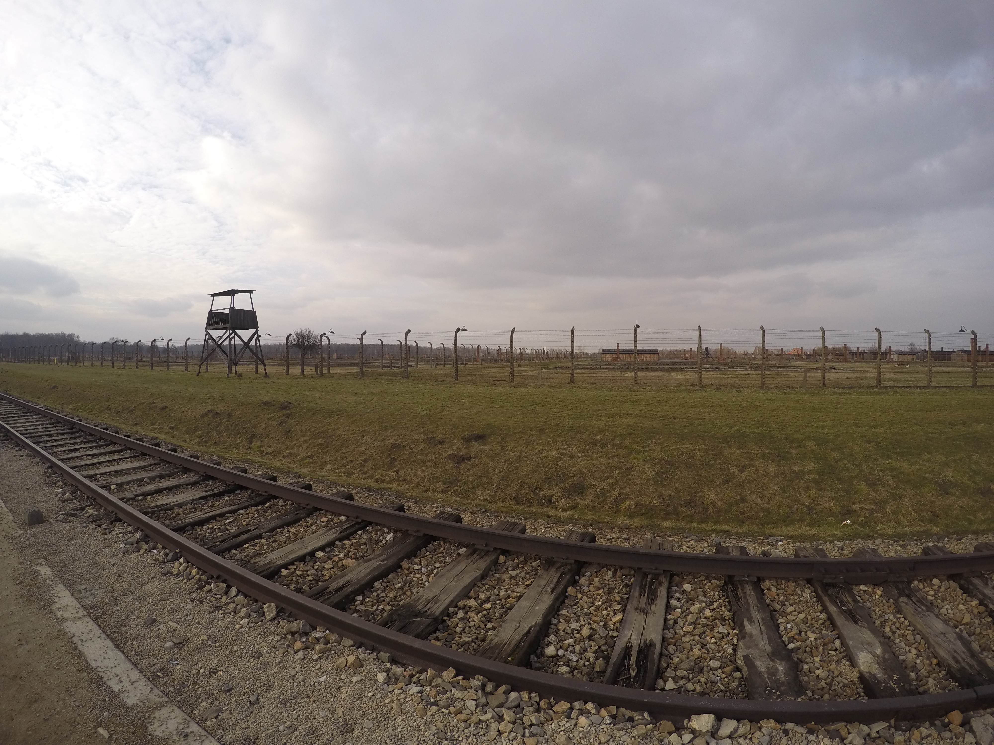 Birkenau and the railroad lining the camp up and down the barracks